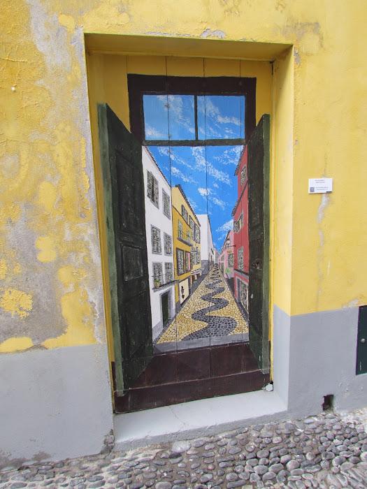 a door painted in a door - Santa Maria street