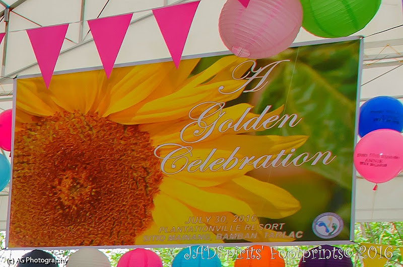 Tarpaulin with Sunflower and A Golden Celebration written on it