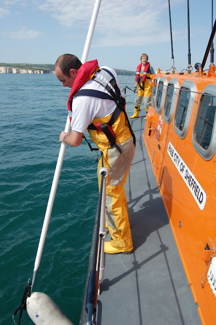 Man overboard exercise (with a fender!). We don't bring people in with a boat hook though!