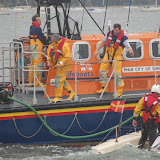 Poole all-weather and inshore lifeboat crews assisting a sinking dinghy