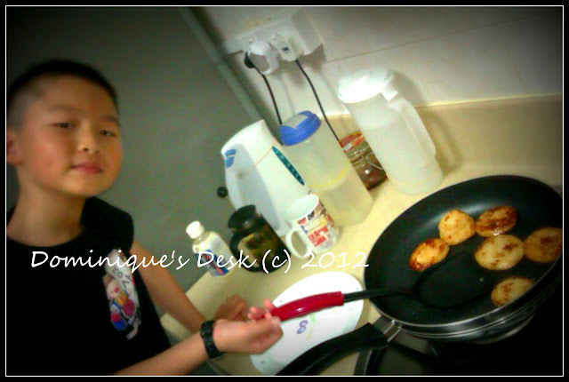 Monkey boy frying fishcakes