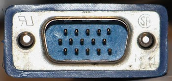 The VGA connector consists of 3 rows of 5 pins. Pins are simply numbered left-to-right with 1 through 5 in the first row, 6-10 in the second, and 11-15 in the third. (Click image for a closeup.)