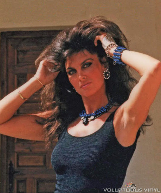 Caroline Munro sexy in a black tank top.