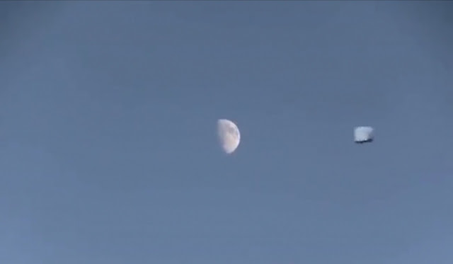 Stunning UFO Passing by the Moon.