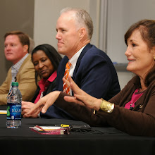Kathie Day answers an audience question during the Cecil B. Day Inaugural Event.  Shown left to right:  Dennis James, Seletha Butler, Peyton Day, Kathie Day