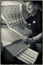 Photo: Mark - head of print services at Chalkboards Uk showing off one of his latest poster designs