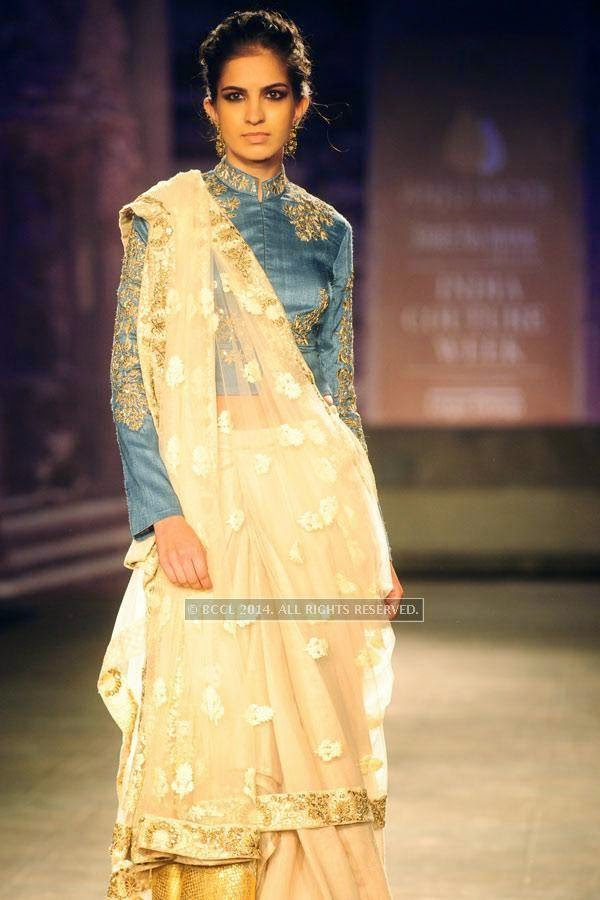 A model walks the ramp for Anju Modi on Day 2 of India Couture Week, 2014, held at Taj Palace hotel, New Delhi.