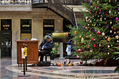 A security guard in Buffalo. His rescue dog. And a little bit of Christmas cheer