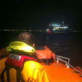 Trainee Crew Member Lewis Singleton keeps an eye on the 13.4m motorboat casualty vessel as the ferry approaches during the ALB's call out on 1 October 2013 Photo: RNLI Poole/Dave Riley