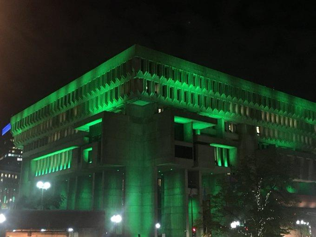 "Boston City Hall was bathed in green light on Thursday night, 1 June 2017, responding to the Trump announcement that he would be withdrawing the U.S. from the Paris climate agreement. Boston Mayor Martin J. Walsh said the choice of decorative light was meant to symbolize Boston standing ""with the environment"". Photo: Martin J. Walsh / Twitter"