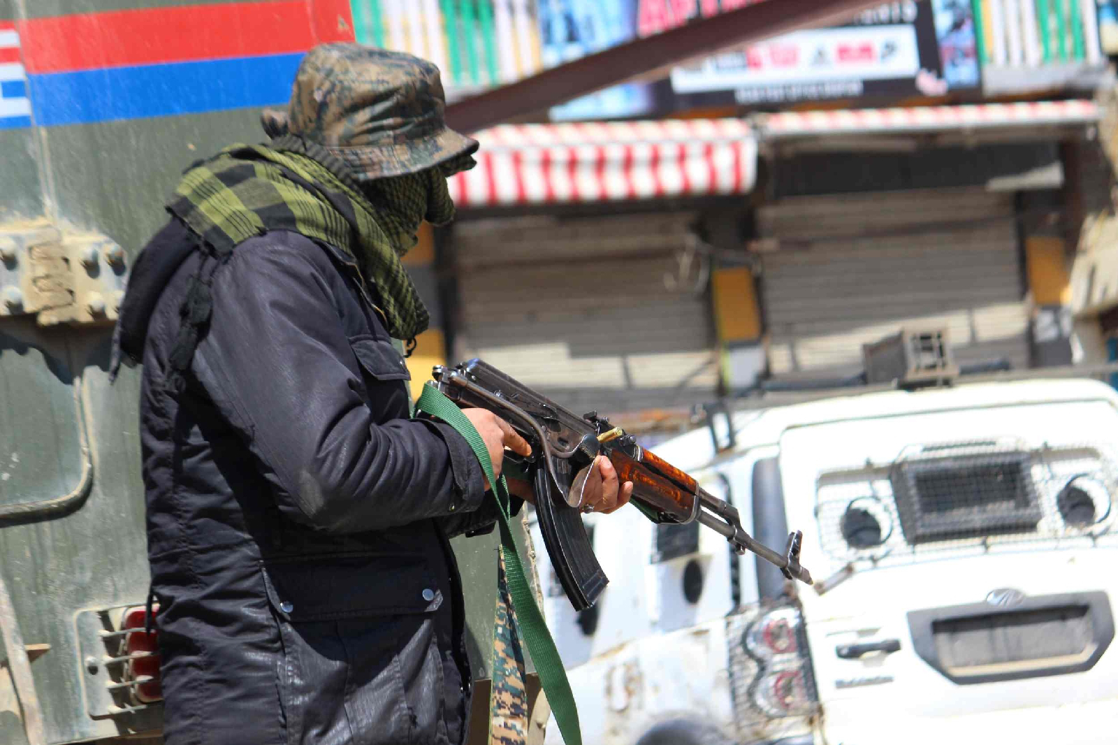An Army soldier takes position during encounter South Kashmir's Shopian