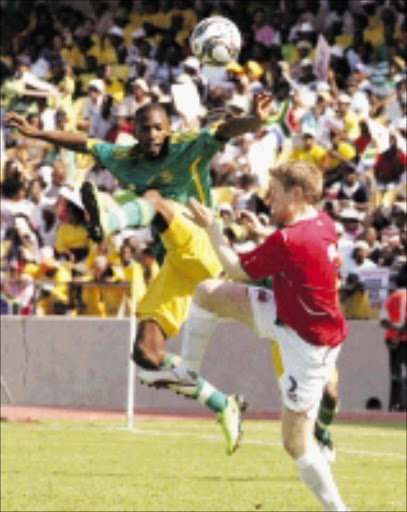 HIGH FLYERS: Bernard Parker of South Africa and Tom Hogil of Norway during the Nelson Mandela Soccer Challenge in Rustenburg. 29/03/09. Pic. Veli Nhlapo. © Sowetan.