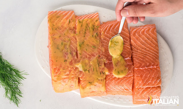 spooning sauce on salmon