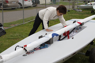 Photo: Mom Joyce is keen to help out too - carefully drying and de-rigging the boat.