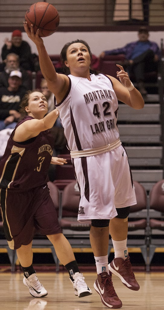 Player of the Game Shanae Gilham lays in another two points as MSU-Northern's Rachelle Bennett pursues.  Gilham was unstoppable, scoring a team-high 12 points and three assists.  Dahlberg Arena in Missoula, Mont., November 13th, 2012.