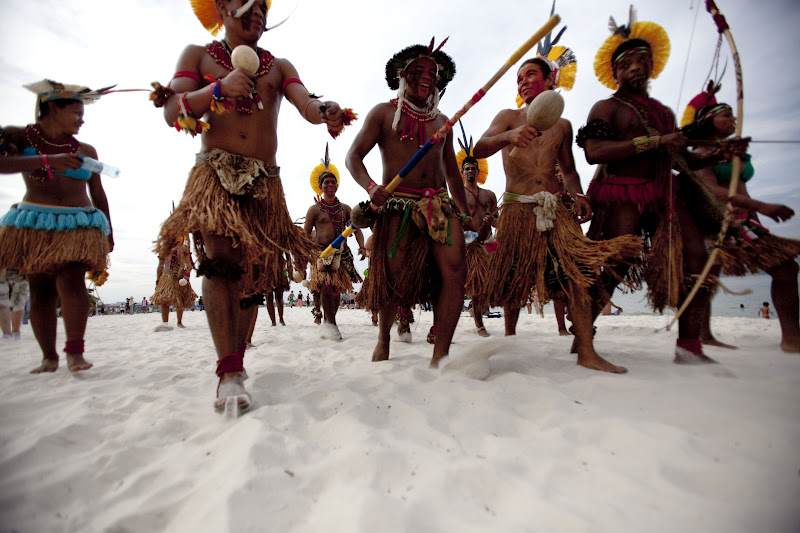 Indigenous marchers on Rio's Flamengo Beach on June 19, 2012. Their bodies formed the lines of an enormous image promoting the importance of free-running rivers, truly clean energy sources like solar power and including indigenous knowledge as part of the solution to climate issues. The activity was led by Brazil's many indigenous peoples organized under the umbrella of the Articulation of Brazilian Indigenous Peoples. ©Caroline Bennett