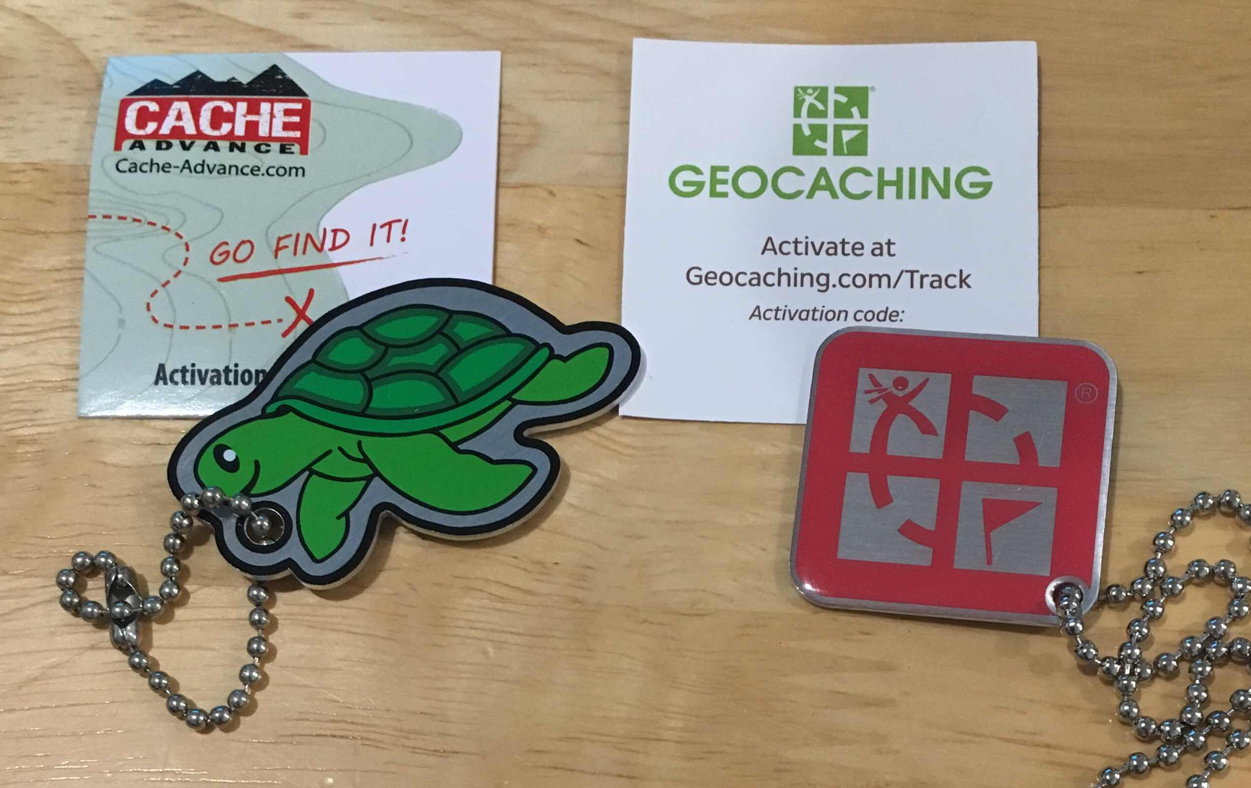 Turtle and geocaching logo trackable keyrings