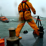 Poole crew member clipped on with his safety harness on the foredeck during an exercise with Swanage lifeboat in rough weather - 26 January 2014 Photo: RNLI Poole/Rob Inett