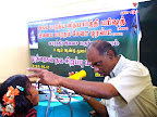 Dr.R.Mahalingam attending a patient :: Date: May 14, 2007, 11:12 AMNumber of Comments on Photo:0View Photo