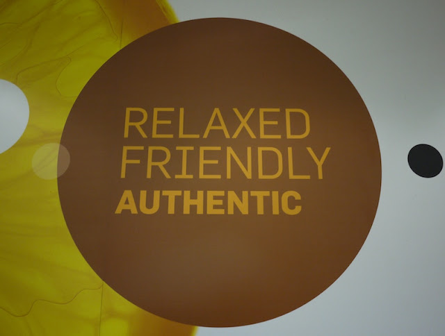 sign inside KFC saying RELAXED, FRIENDLY, AUTHENTIC
