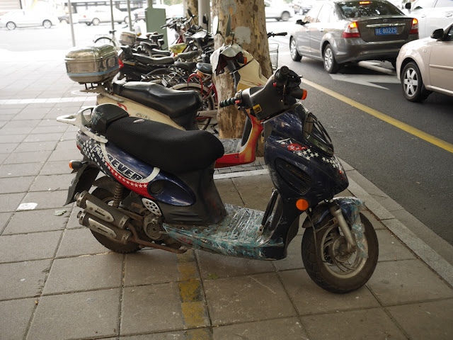 "motorbike with a red, white, and blue design with white stars and the word ""FOREVER"""