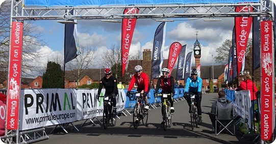 Cyclists cross the finish line  within Queens Park Crewe