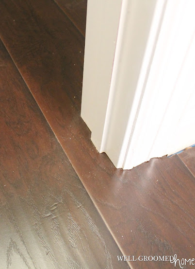 Select surfaces laminate hardwood flooring well groomed home for Flooring surfaces