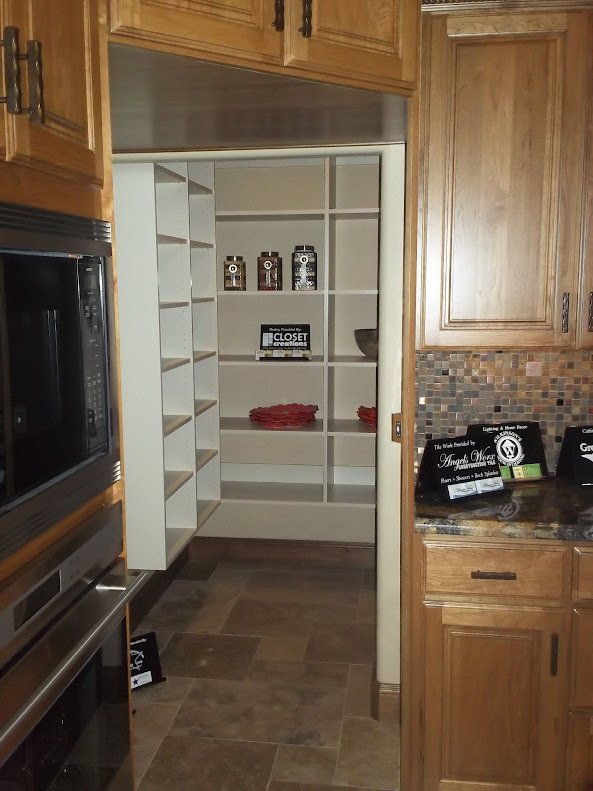 Love this large walk in pantry hidden by all the cabinets for Large walk in pantry