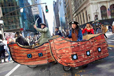 Protesters affiliated with the Occupy Wall Street movement riding bicycles made to look like pirate ships, march to the Bank of America Building at 42nd Street and Sixth Avenue in New York October 28, 2011. The march visited the headquarters for Bank Of America, Morgan Stanley and JP Morgan Chase. REUTERS/Andrew Burton (UNITED STATES - Tags: CIVIL UNREST POLITICS SOCIETY TPX IMAGES OF THE DAY)