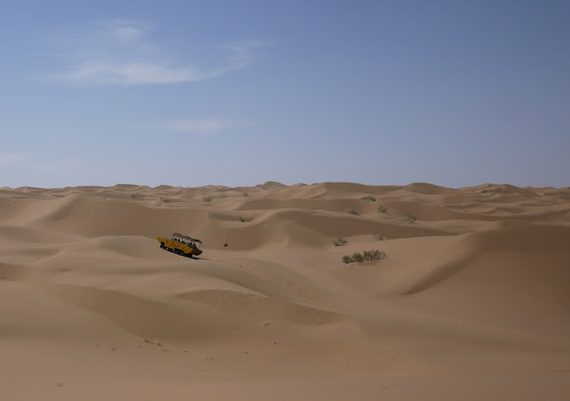 large vehicle in the dessert at Shapotou in Ningxia