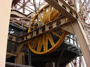 One of the flywheels on the Eiffel Tower's elevator.  The elevator system is the original system from 1890.