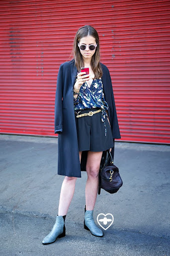 Taylor Cassidy; merchandiser; Kenzo Tiger phone cover; Illesteva glasses; vintage jacket and shirt, Topshop shorts; Clare Vivvier bag; Philip Lim shoes