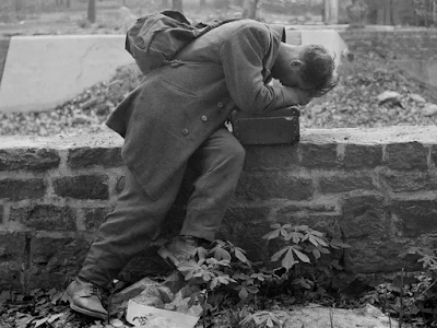 Defeated German soldier returns home after WW!