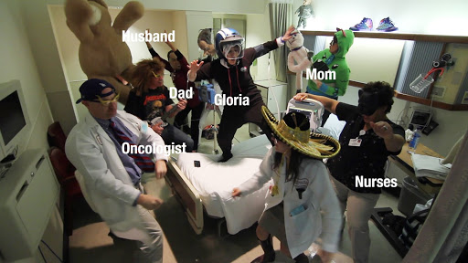 Gloria Borges, dancing with friends and hospital staff during her 45th round of chemotherapy. From the film Pursuing Happiness