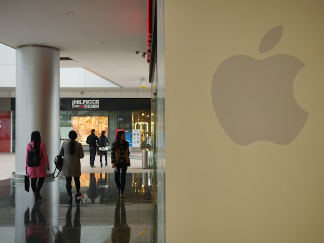"darker, more visible ""hidden"" Apple logo on a wall outside the Xiamen Apple Store"