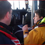 Lifeboat Training Coordinator Paul Taylor running through lifeboat layout with new trainee Lewis Photo (from video): RNLI/Anne Millman