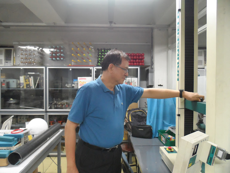 Dr. Benjamin Chan checks the Universal Testing Machine in the Materials Physics Laboratory