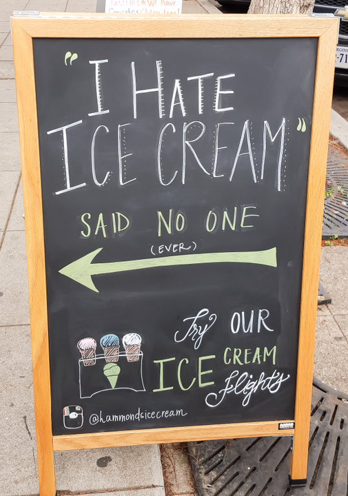 photo of a chalk board sign outside the location