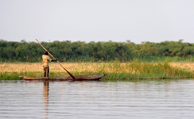 A man paddling a Mokoro