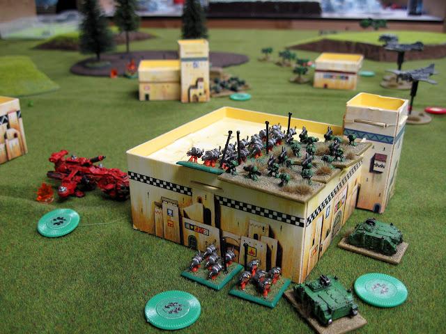 Chris's Assault Marines work over my Devastators.