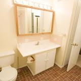 Upstairs full bath.  Light bar above sink.  Door to upstairs on the right.  Bathroom closet behind main door.