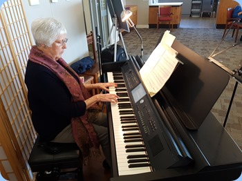Claudette Wheeler playing the Village's Yamaha Clavinova CVP-709