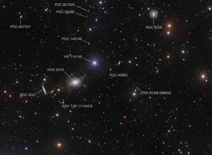 galáxia elíptica NGC 5018 e sua vizinhança