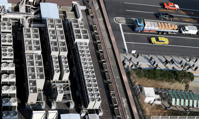 Aerial view of multiple air-conditioning units on a Tokyo roof. Photo: Franck Robichon / EPA