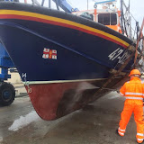 Poole's Tyne class lifeboat's 'bottom' being pressure-washed and cleaned. 31 March 2014 Photo: Paul Taylor
