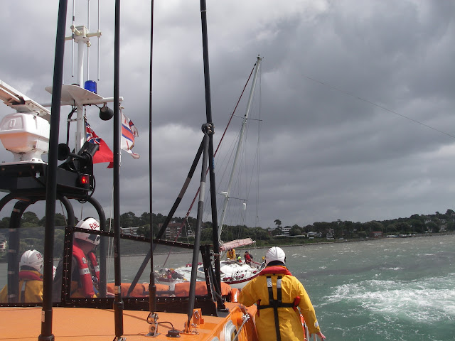 22 May 2011 – ILB (to right of picture) going astern and pulling on tow rope attached to yacht's halyard while ALB towing ahead