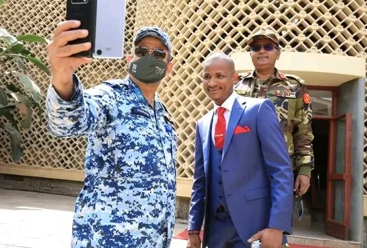Embakasi East Mp hon Babu Owino with Asian soldiers photo