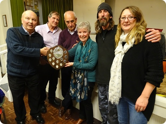Winning team The Hall Stars receive the Fred Lorimer trophy from Peter and Christina Wainwright