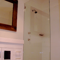 After » Shower and Vanity Renovated » Including Ken's signature recycled timber on the mirror.