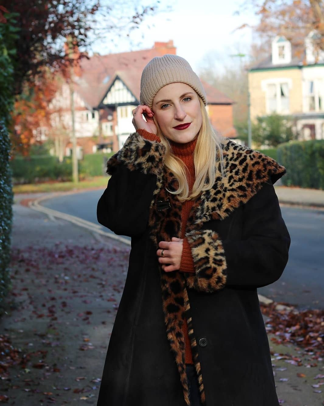 Amy in a vintage black faux suede coat with leopard print faux fur cuffs and collar